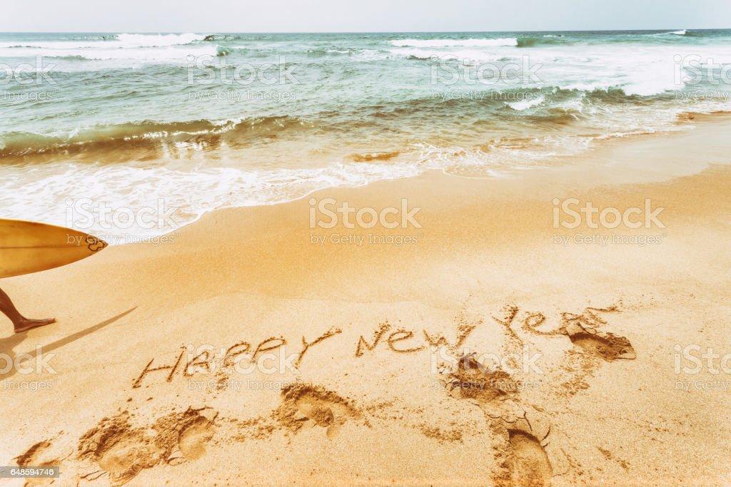 New Year text on the sea beach. Retro vintage. stock photo