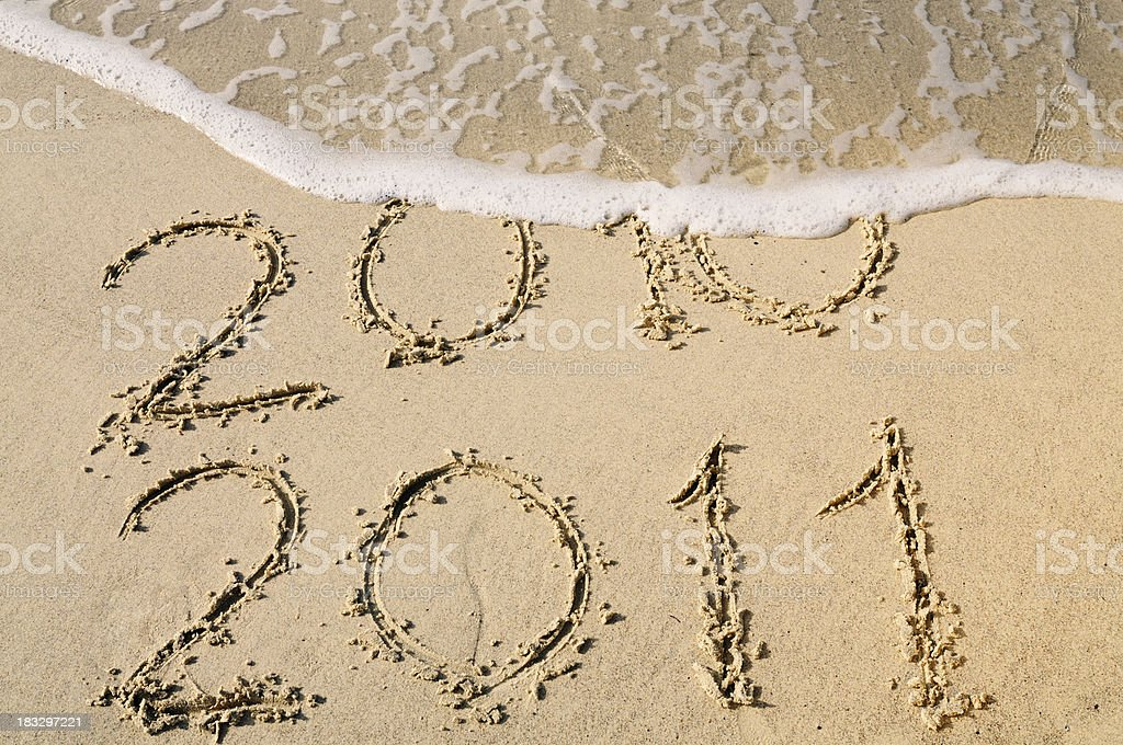 New Year Written in the Sand W a Wave royalty-free stock photo