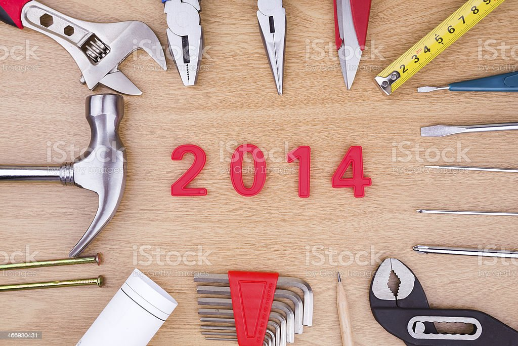 New years 2014 and work tools background stock photo