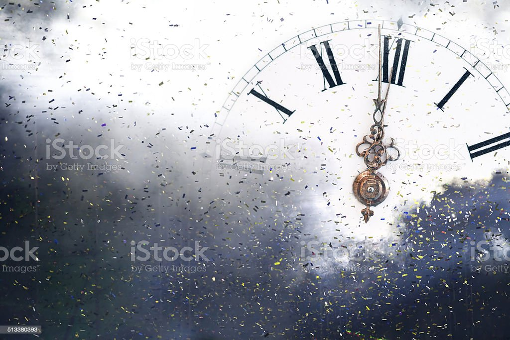 New Year's at midnight - Old clock and holiday lights stock photo