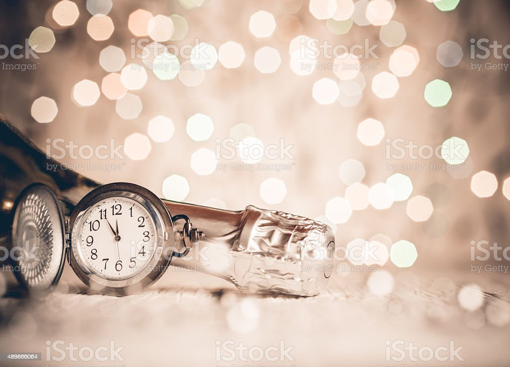 New Year's clock and champagne at midnight stock photo