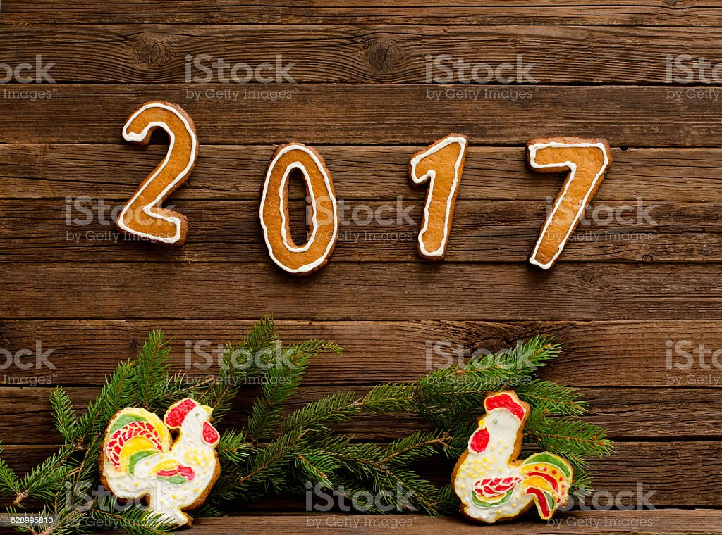 New Year's concept. Figure 2017 and two roosters from gingerbread stock photo