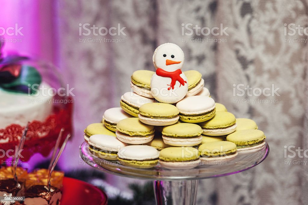 New Year's concept. French Macaroons on a glass stand stock photo