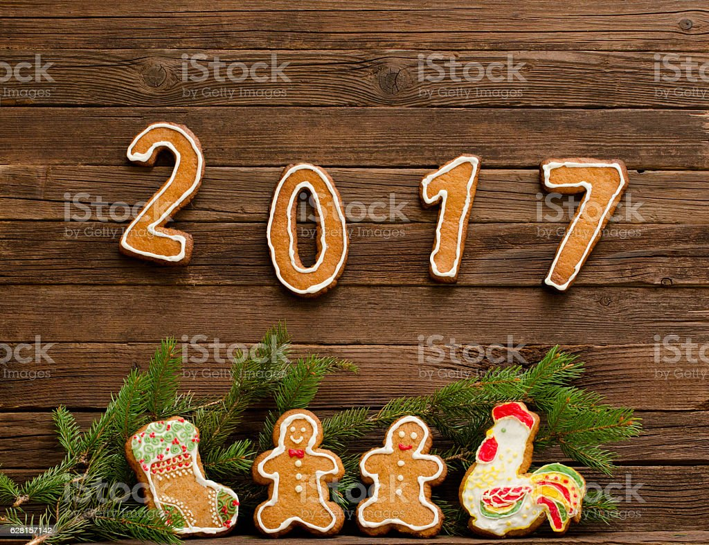 New Year's concept. The figure in 2017 and gingerbread stock photo