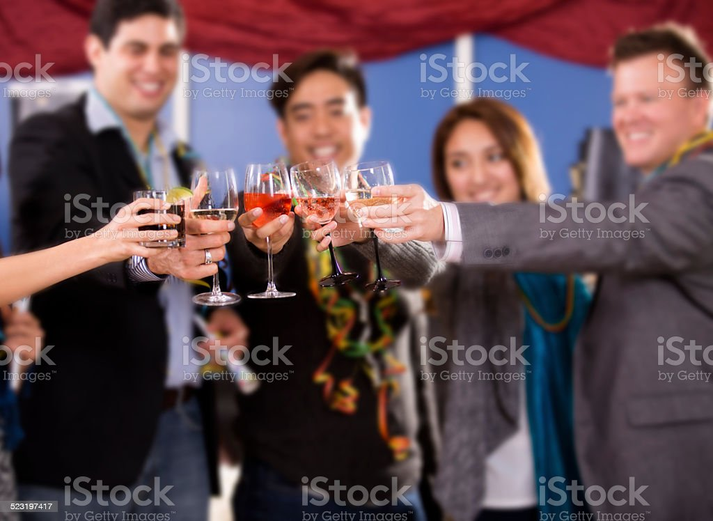 New Year's Eve celebration. Multi-ethnic group of friends. Party. Drinks. stock photo