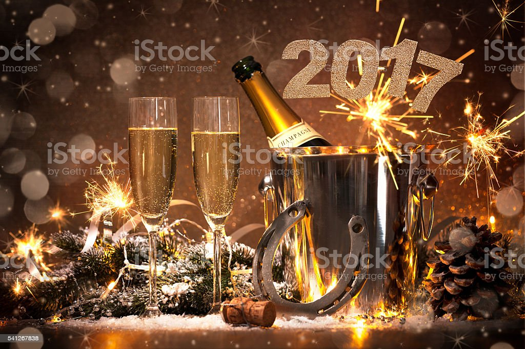 New Years Eve celebration background with pair of flutes and bottle...
