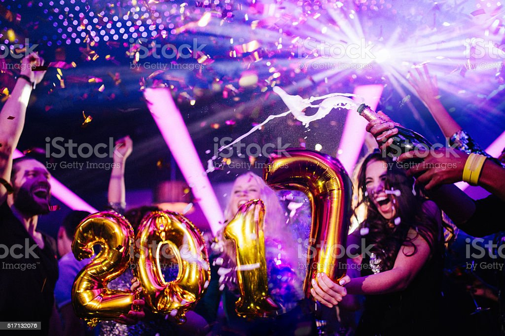 New Years eve celebration with friends in night club party stock photo
