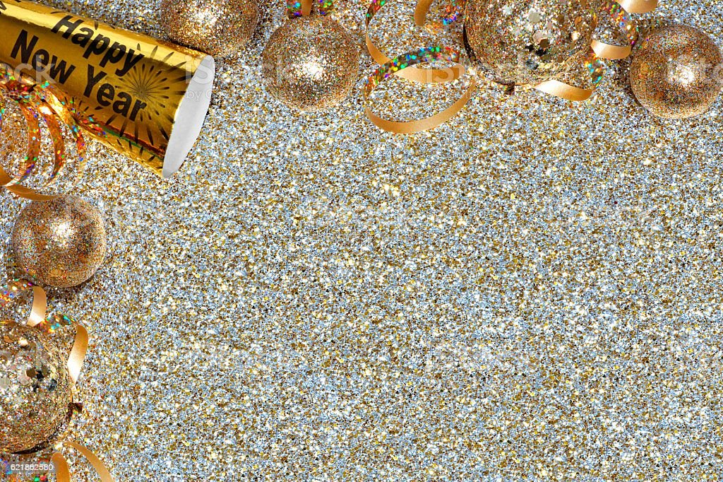 New Years Eve corner border over a golden background stock photo