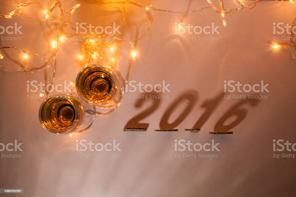 New Year's Eve, 2016, lights,  figures , shadows and glasses of stock photo