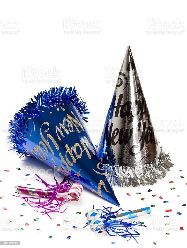 New Year's Eve party hats and glitter stock photo