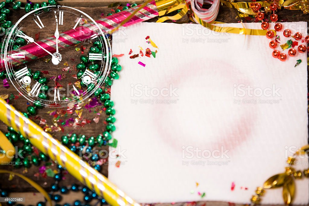 New Year's Eve Party!  Napkin, wine stain. Confetti, streamers. Clock. stock photo