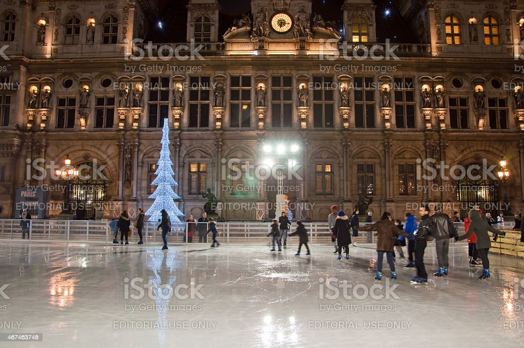 New Year's ice skating in front of Hotel de ville. stock photo