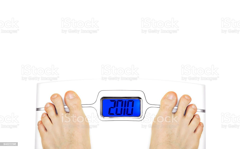 New Years Resolution 2010 scale royalty-free stock photo