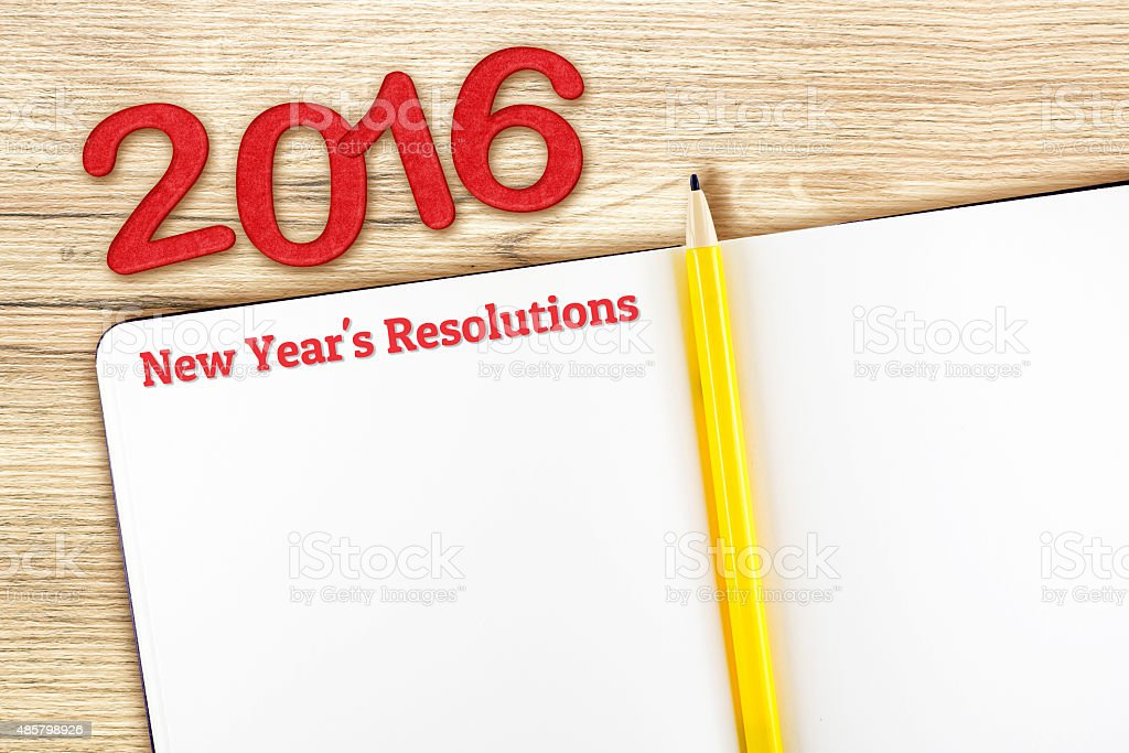 New year's resolutions word on notebook lay on wood table stock photo