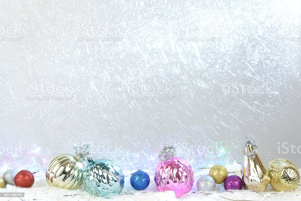New Year's toys on the background of frozen window stock photo