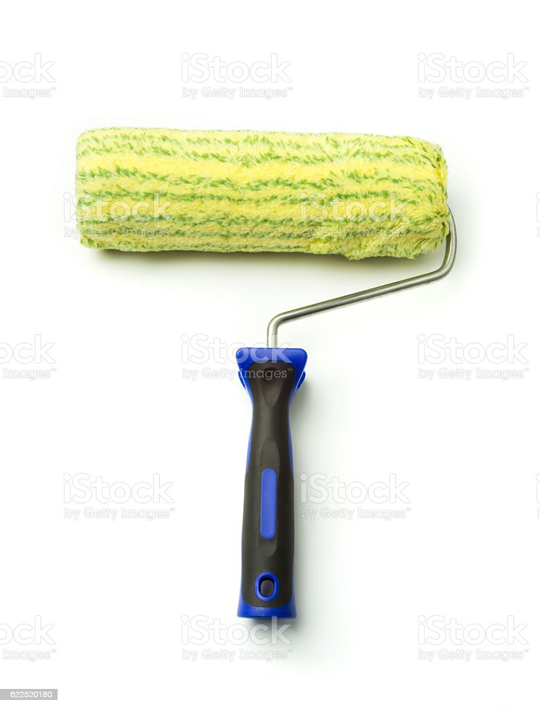 New yellow green paint roller brush close up isolated stock photo