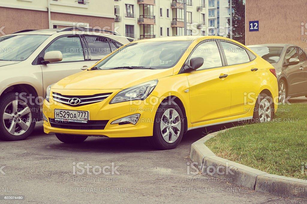 New yellow Hyundai Solaris. stock photo
