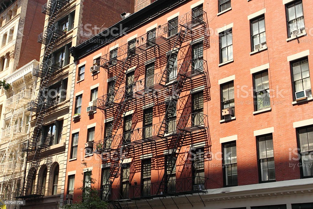 New York brick buildings with outside fire escape stairs, stock photo
