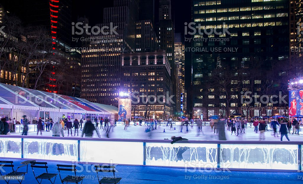New York Bryant Park Winter Village Ice Skating at Night stock photo