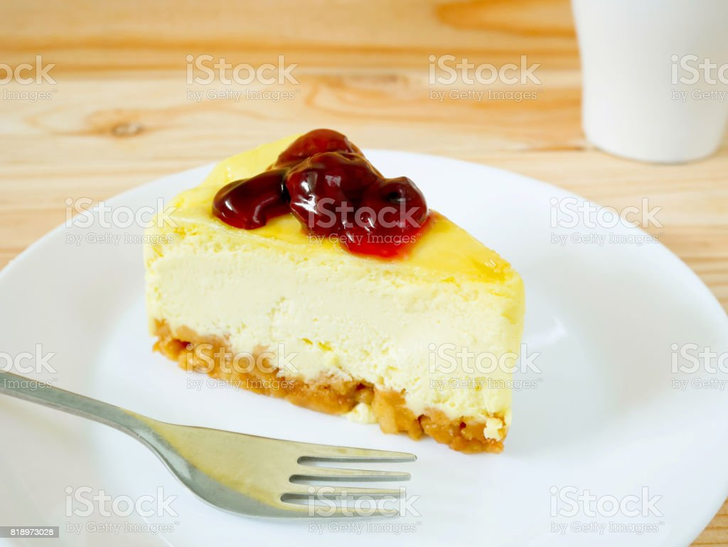 New York Cheesecake with berry sauce on white plate stock photo