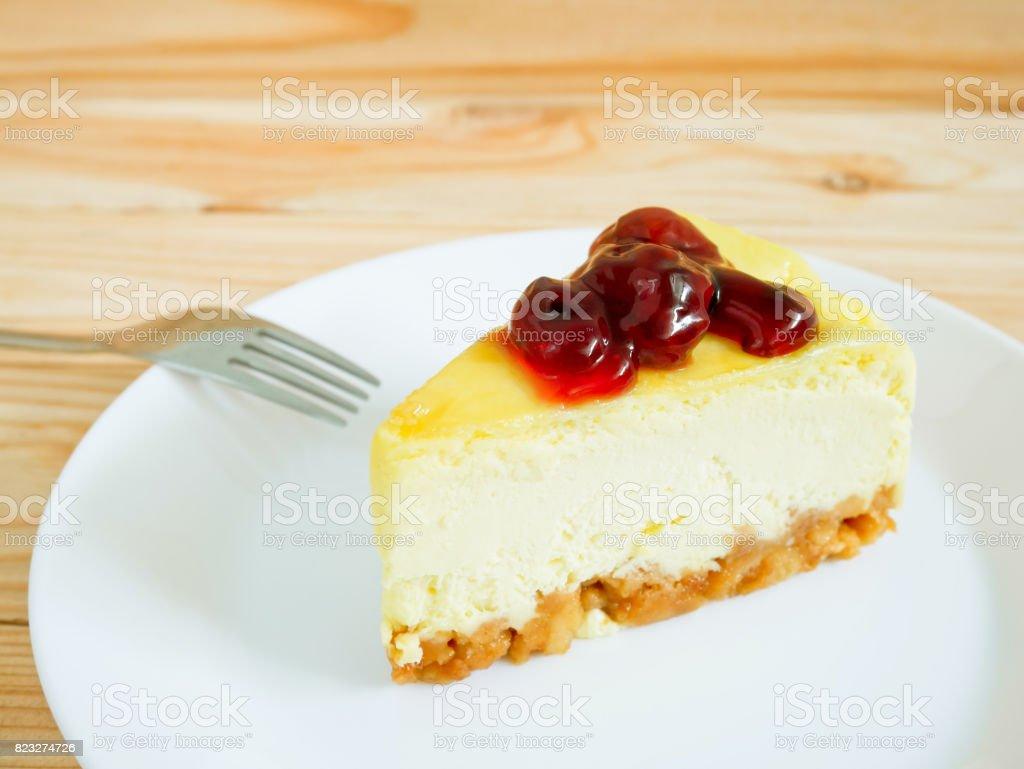 New York Cheesecake with berry sauce stock photo