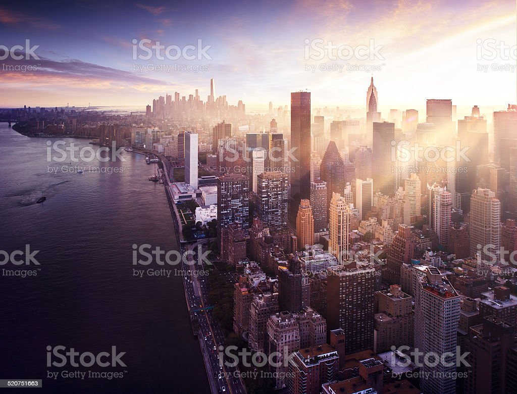 New York City beautiful colorful sunset over manhattan stock photo
