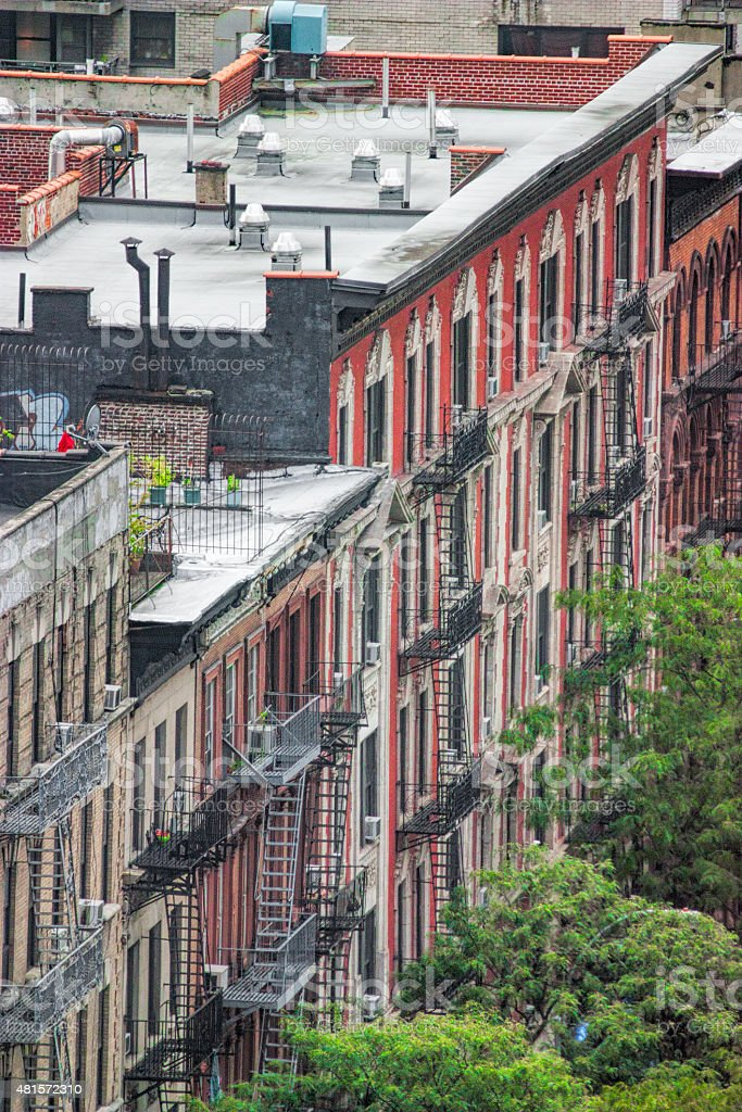 New York City Brick Tenement Apartments With Metal Fire Escapes stock photo