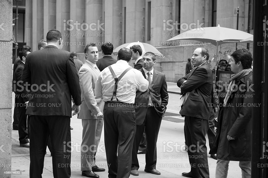 New York City Businessmen Talking on Wall Street royalty-free stock photo