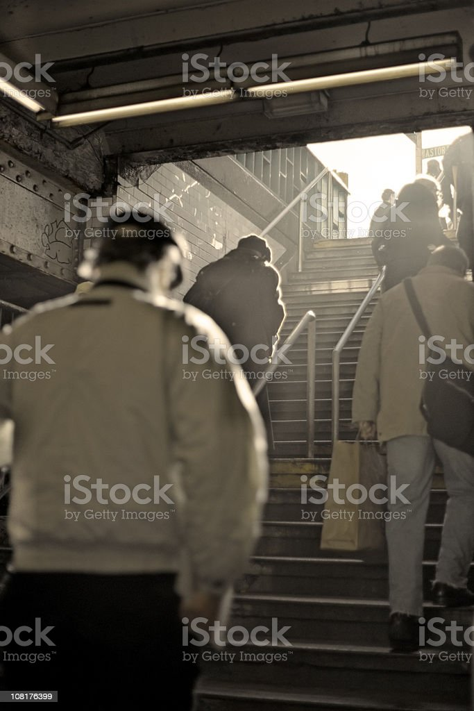 New York  City Commuters Clambering up Subway Steps royalty-free stock photo