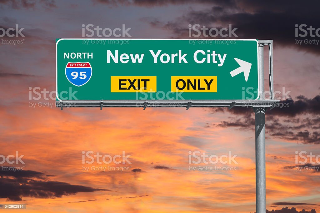 New York City Exit Only Highway Sign with Sunrise Sky stock photo
