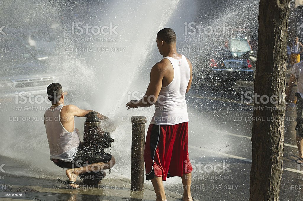New York City Fire Hydrant Summer Day Young Men stock photo