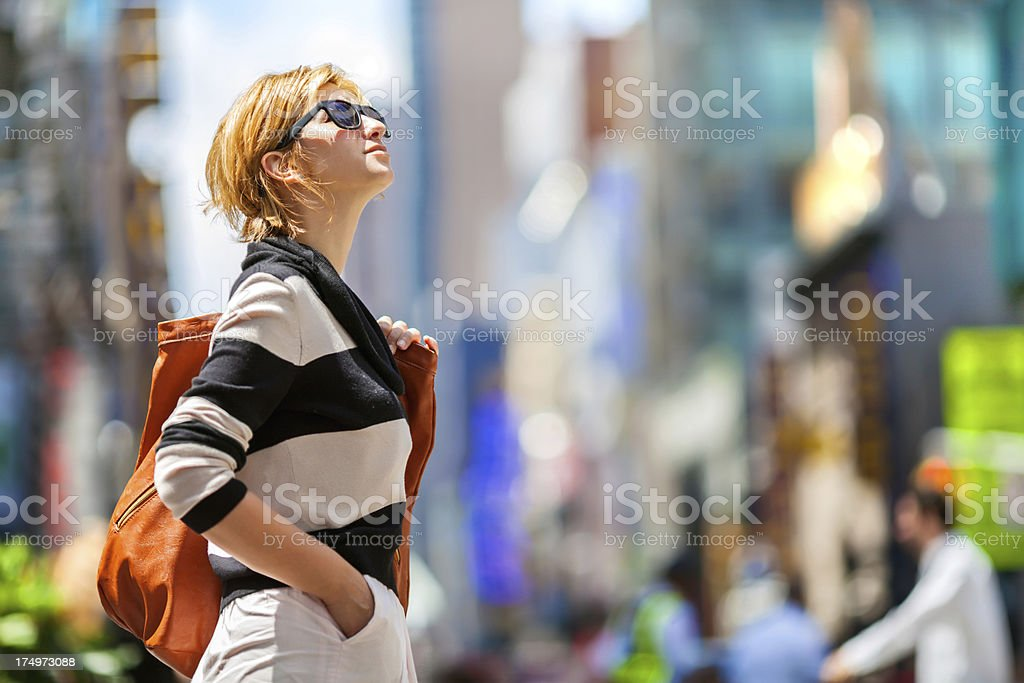 New York City girl with dark specs looking up royalty-free stock photo