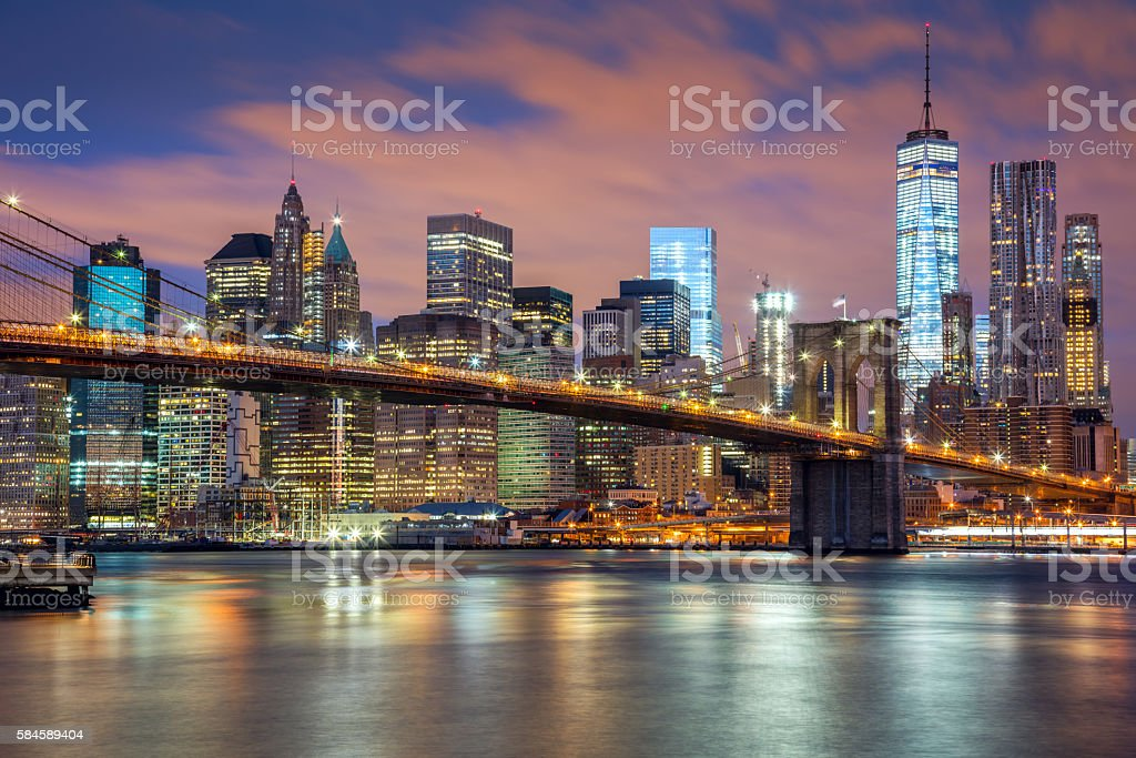 New York City - great illumination and colorful clouds stock photo