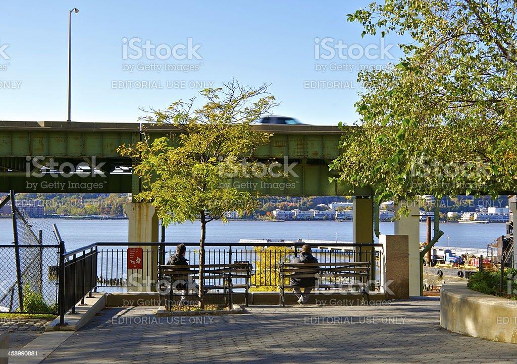 New York City life, people sitting near Hudson River, Manhattan stock photo