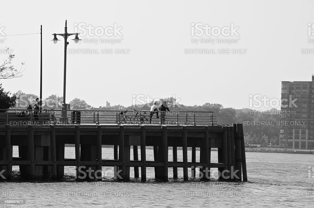 New York City life scene, Bicyclists at Hudson River Pier royalty-free stock photo