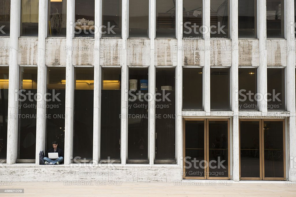 New York City Man on Computer Outside Lincoln Center stock photo