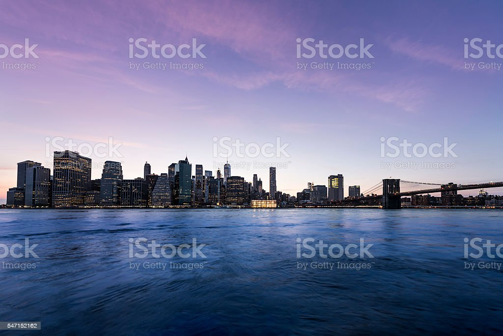 New York City Manhattan skyline at night with Brooklyn Bridge stock photo