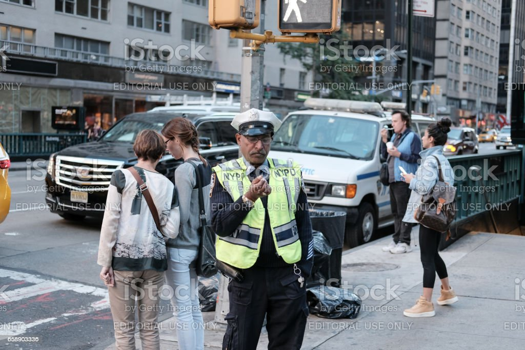 New York City, New York, USA - October 8 2016: Candid shot of an NYPD traffic officer seen near a crossing on the body streets of New York City. stock photo