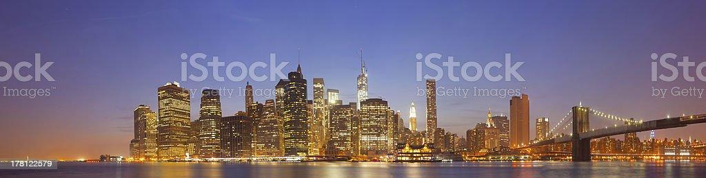 New York city night skyline panorama of Manhattan buildings stock photo