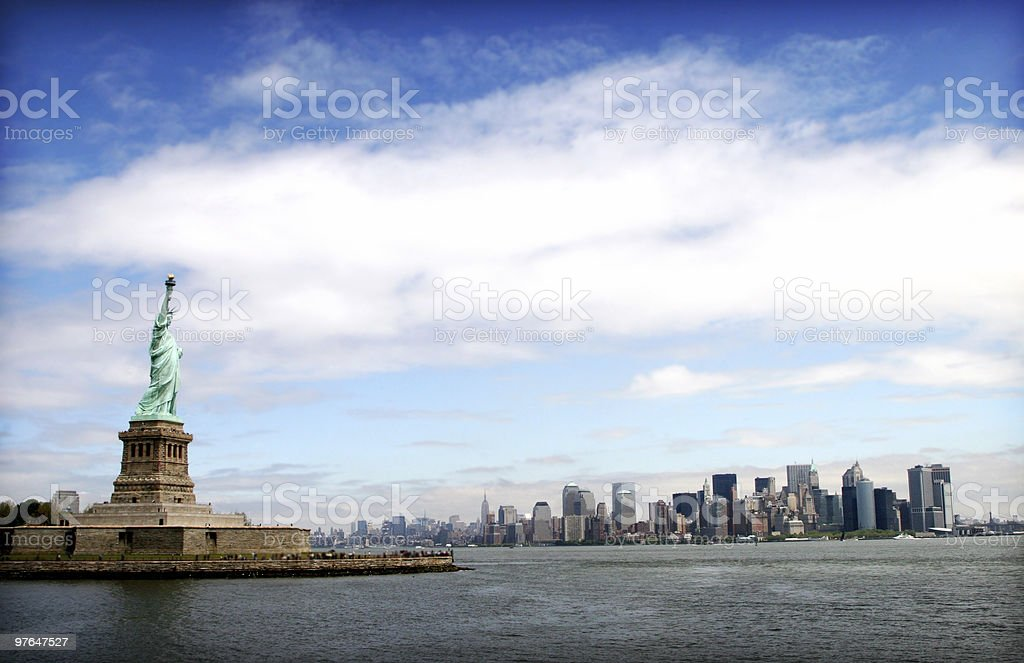 New York City Skyline from a distance with Lady Liberty royalty-free stock photo