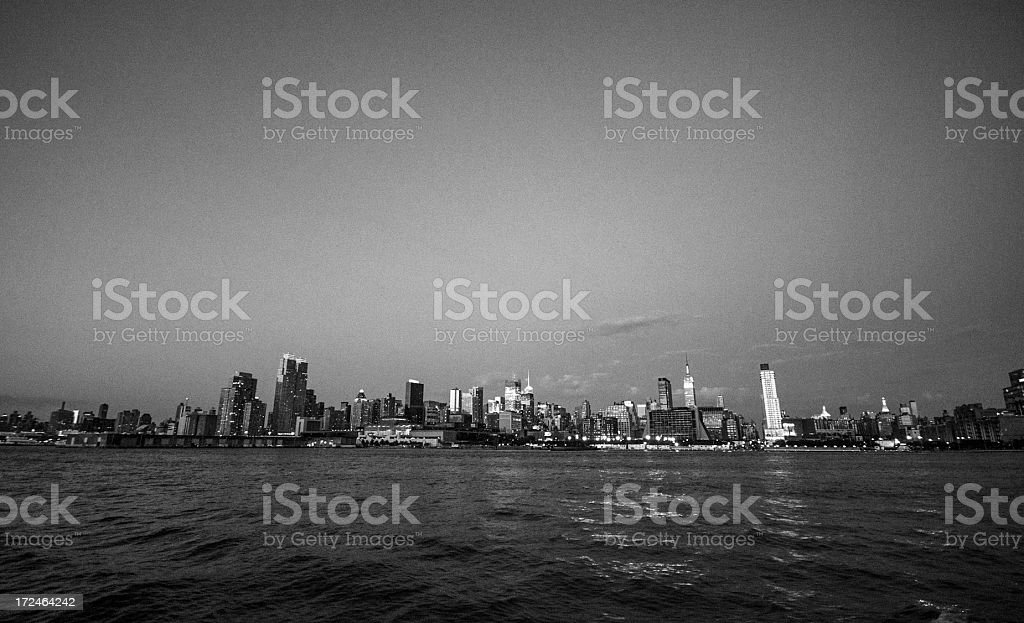 New york city skyline from river in the night royalty-free stock photo