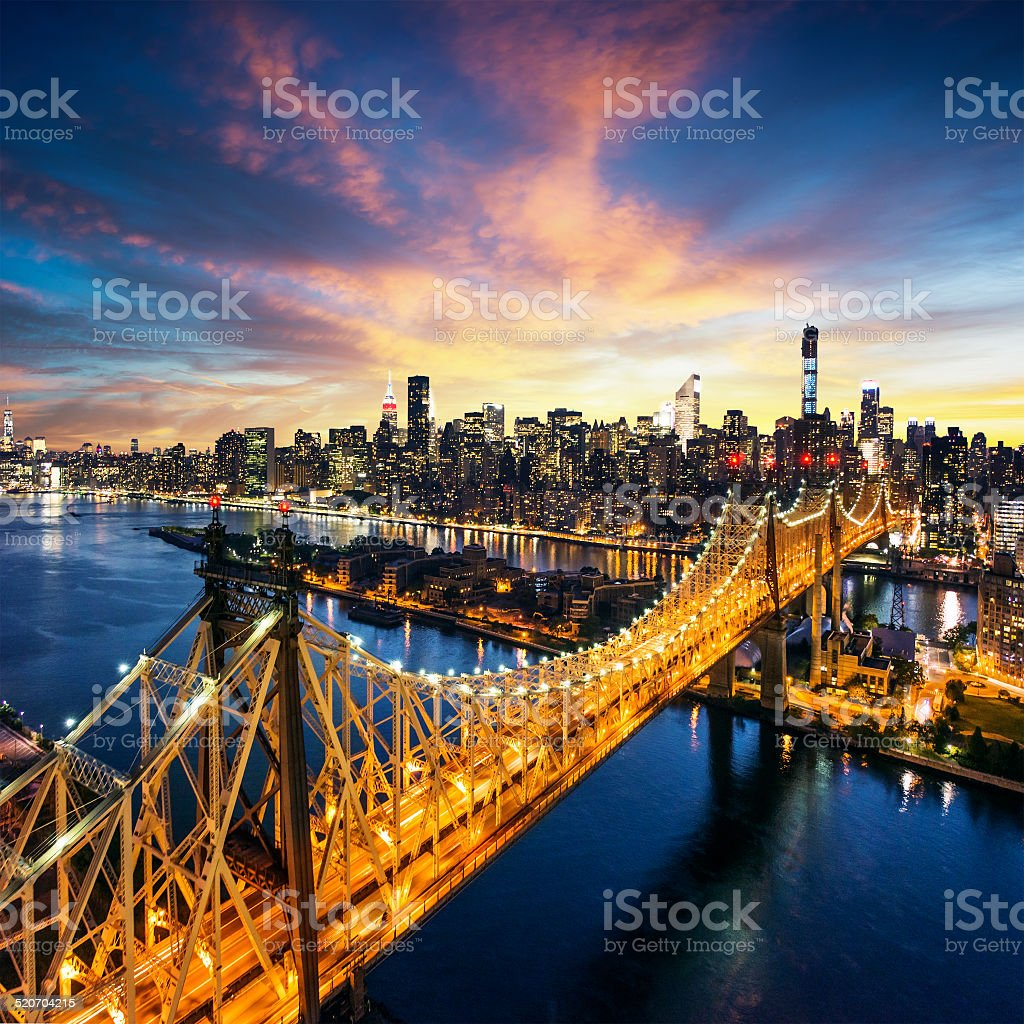 New York City sunset over manhattan with Queensboro bridge stock photo