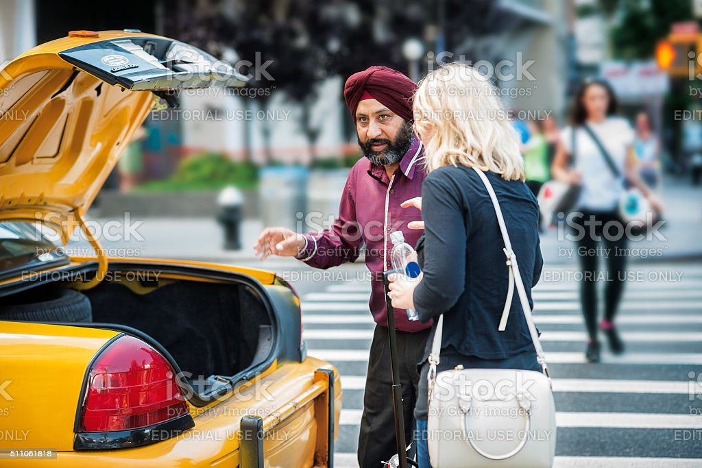 New York city taxi cab driver picking up passenger stock photo