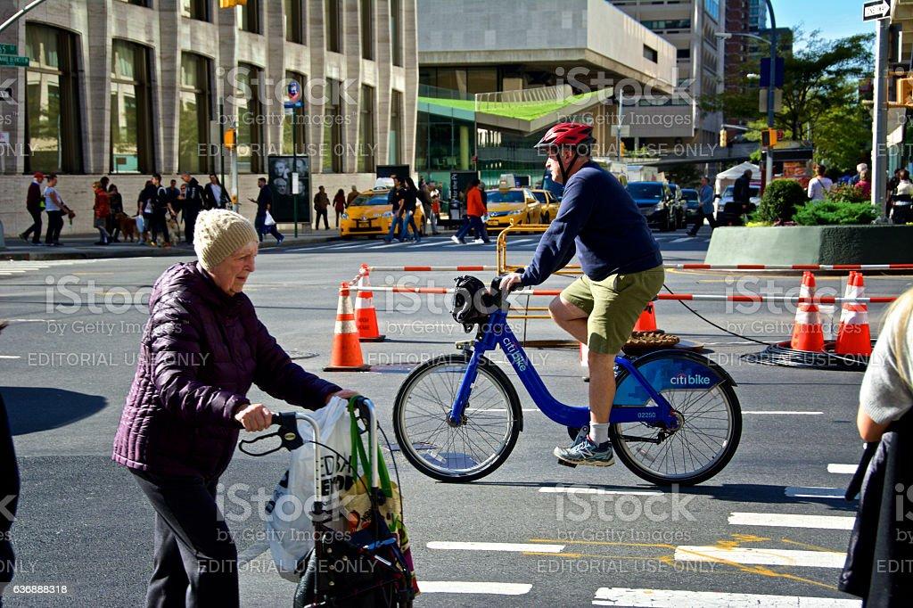 New York City, Urban Life, Elderly Woman,  Bicyclist on Broadway stock photo
