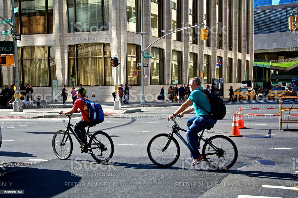 New York City, Urban Life, Father & Son Bicyclists on Broadway stock photo