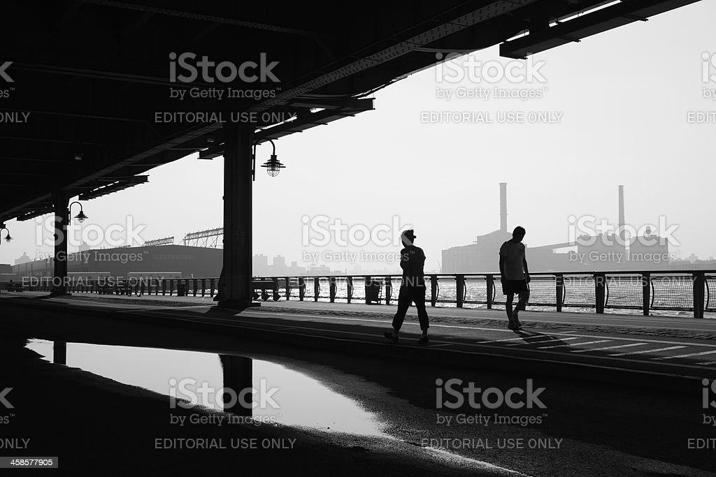 New York City walkers along East River morning stock photo