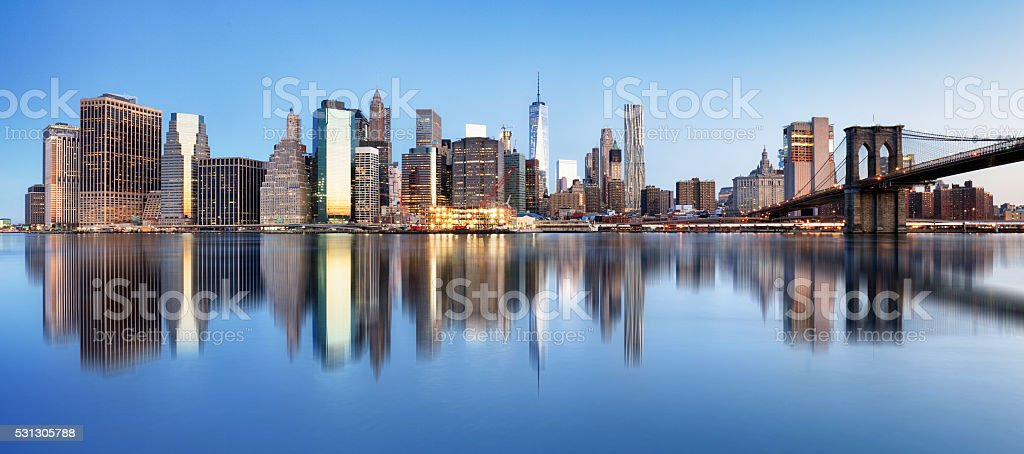 New York downtown panorama with brooklyn bridge and skyscrapers stock photo