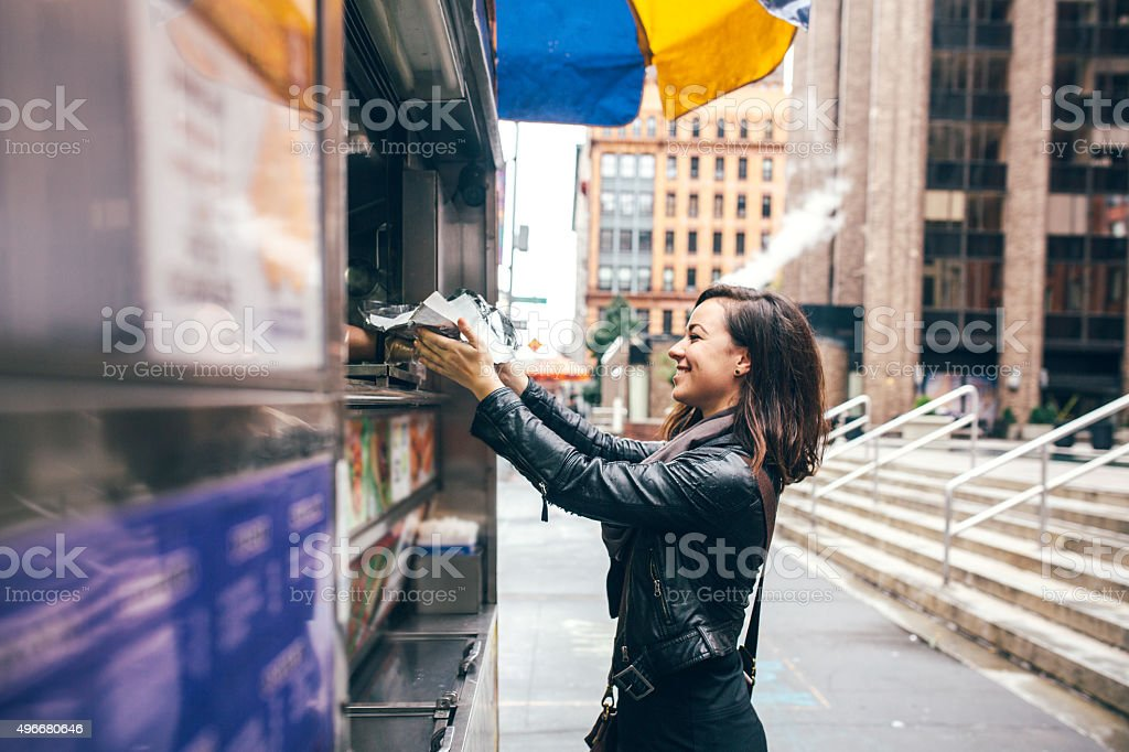 New York Food Cart Customer stock photo