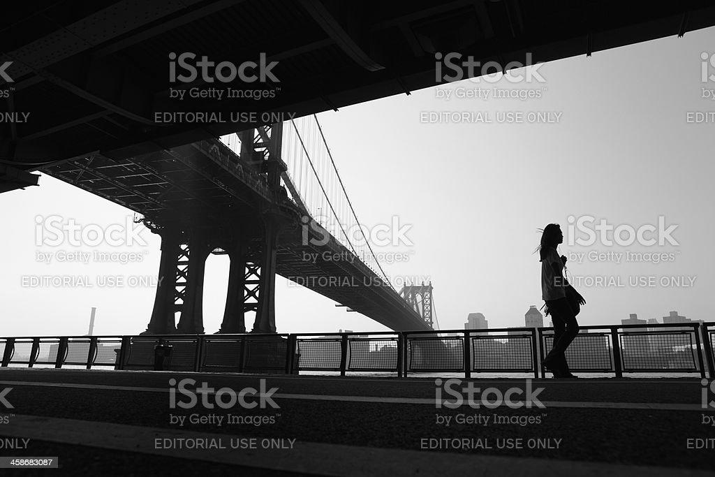 New York girl walking to work under Manhattan Bridge stock photo