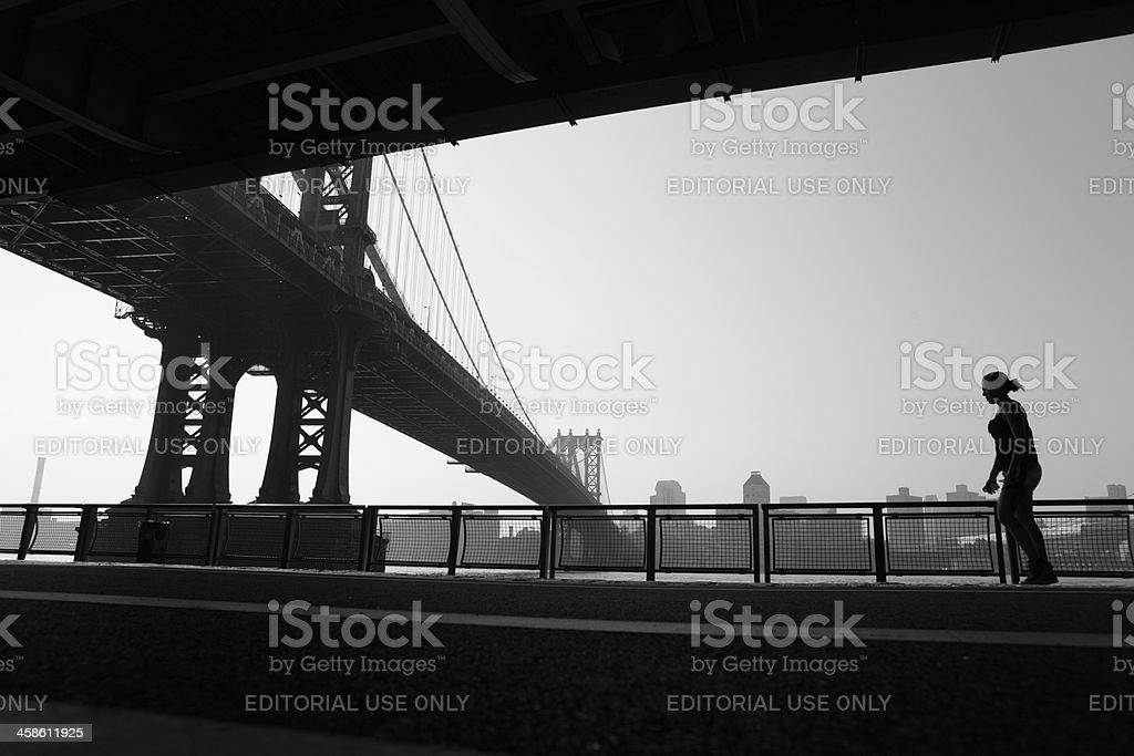 New York jogger and Manhattan Bridge stock photo